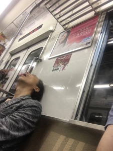 Catching a snooze on the morning train.